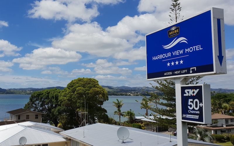 View over waters edge and motel to Tauranga's Inner Harbour.