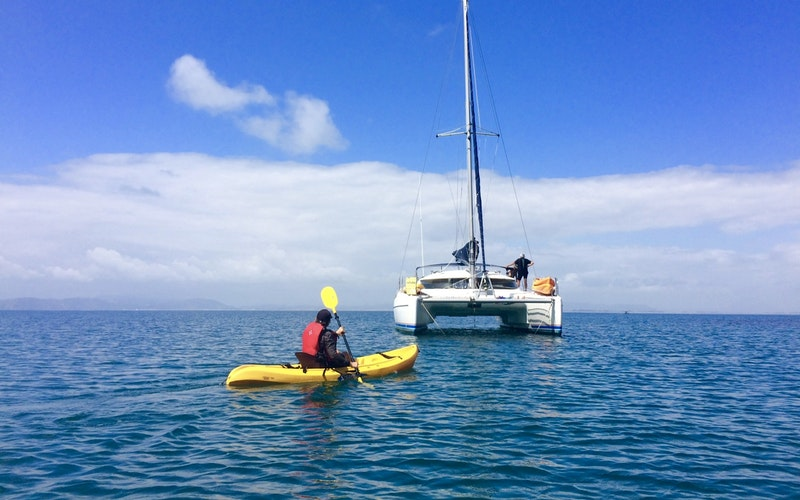 Returning to the catamaran after a great paddle