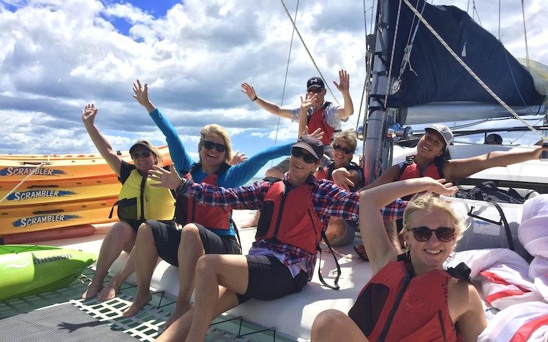 Relaxing on the catamaran on the sail back form Moutohorā / Whale Island