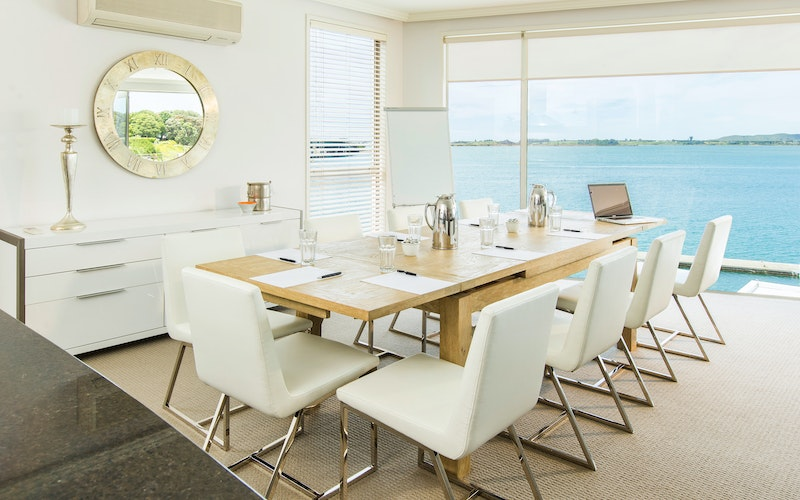 The 12-seater dining room table is the perfect setting for an intimate dinner or productive boardroom meeting.