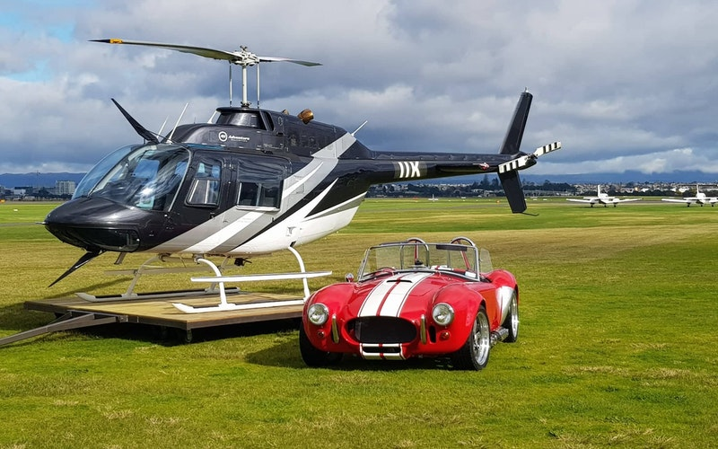 Bell Jet Ranger helicopter and AC Cobra