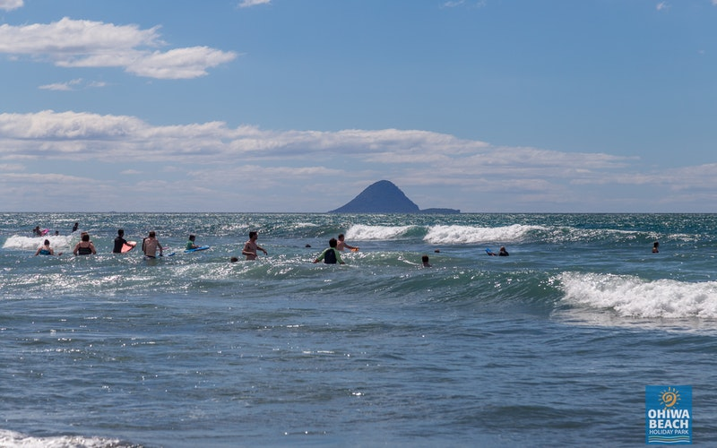 Fun in the Surf at Ohiwa Beach Holiday Park